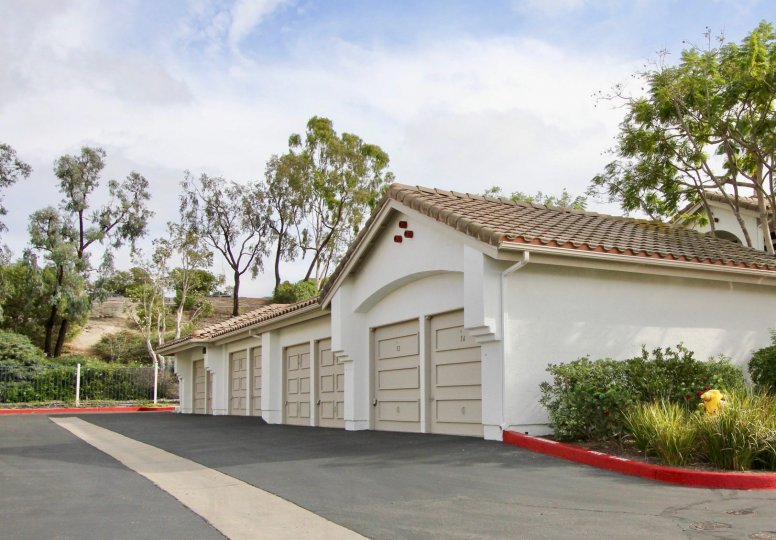 Garages in front of some trees in Mission del Oro in Oceanside, CA