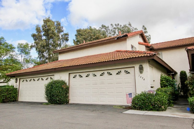 A home with nice tiled roof, extended, two door, garage, in Oceanside California.