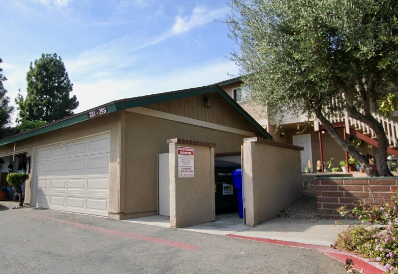 Detached double car garage with access to communal garbage receptacle at Mission Vista in Oceanside, CA