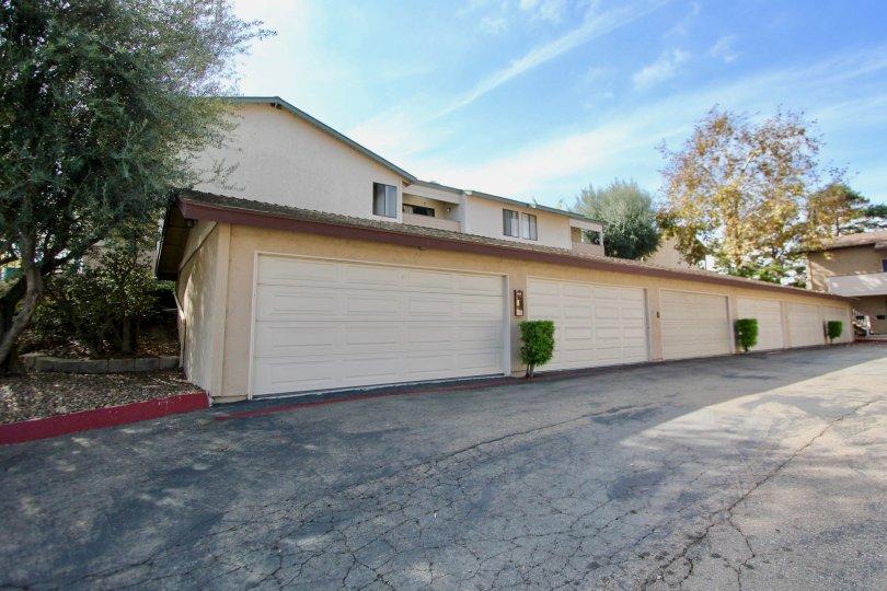 Garages with bushes at Mission Vista in Oceanside, CA