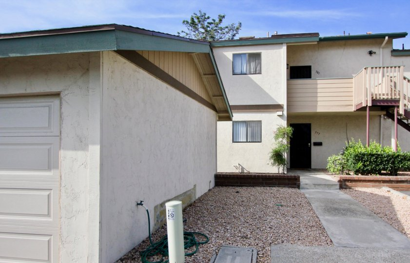Apartment complex with garage in mission vista with stairs in a warm area