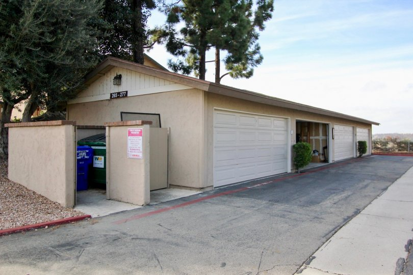 Garages and a dumpster at Mission Vista in Oceanside, CA