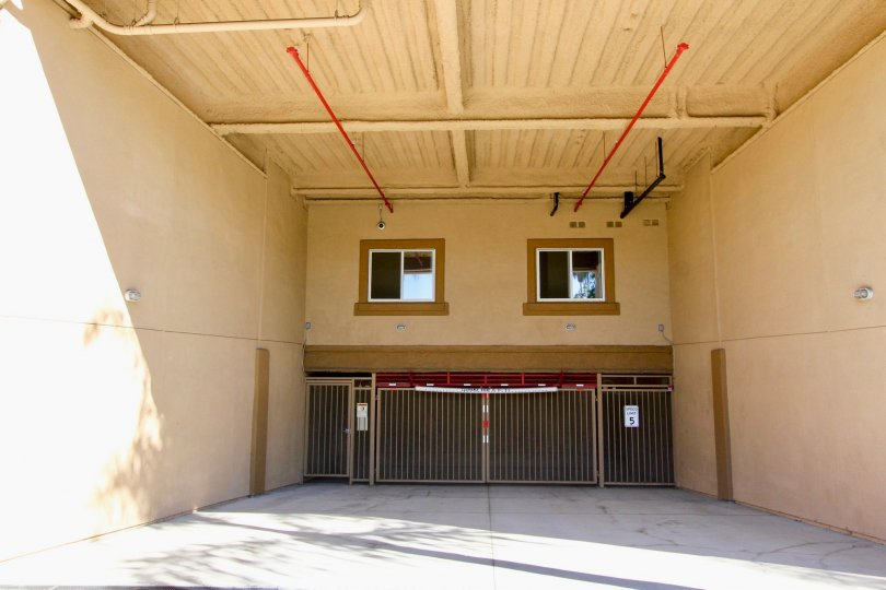 A view of the entrance to the underground garage with privacy gate under the Nevada Manor building.