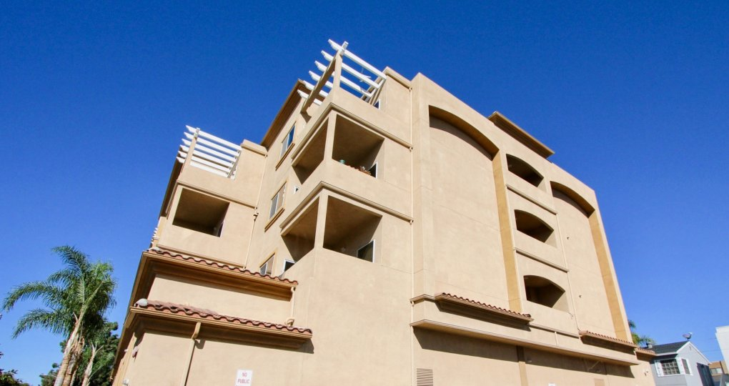 This gorgeous building sits overlooking the palm trees in the Oceanside Sun