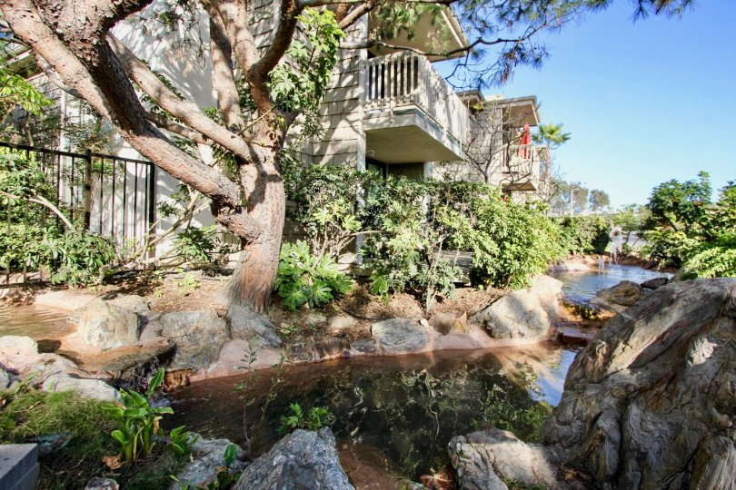Gorgeous professionally landscaped backyard with prominent water feature and 2nd level balconies in North Coast Village, Oceanside, CA