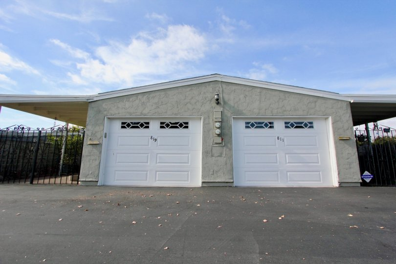 Two white garage doors with windows at Oceana South in Oceanside California