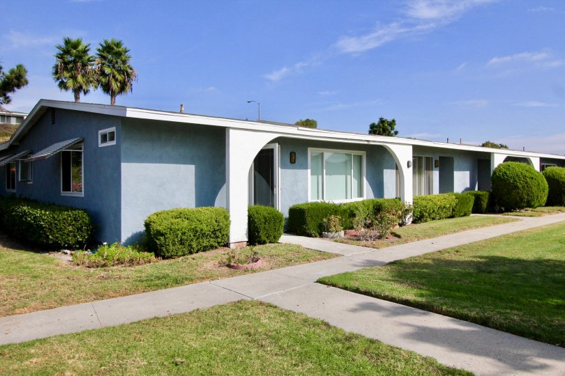 A blue single story condo home inside Oceana South at Oceanside CA