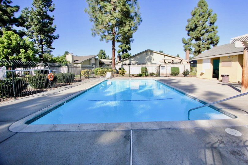 Large gated pool with surrounding houses, located in Orchard Lane, in the city of Oceanside, California.