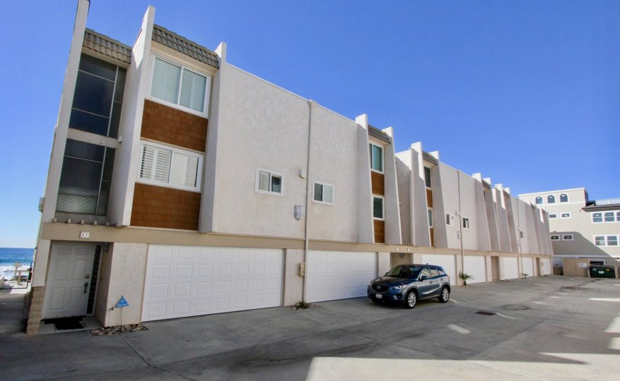 Residential building with car parked in front of garage in Ovard community Oceanside California