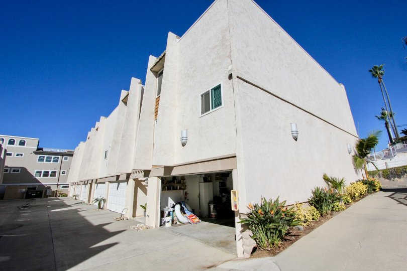 Three story units with plants on the side in Ovard Oceanside CA