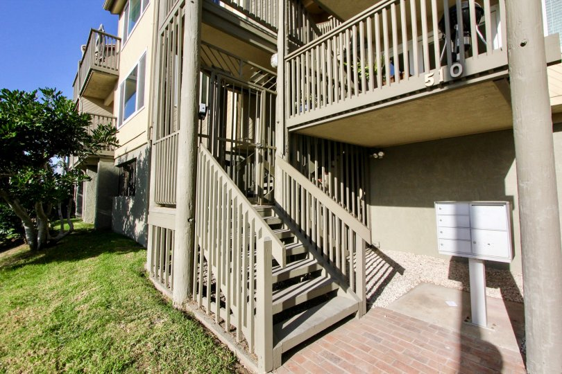 A lawn by some stairs leading to a unit in Pacific Star Pine in Oceanside, CA
