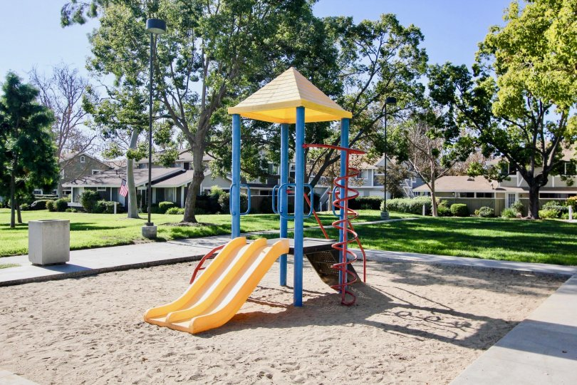 A play ground with colorful equipment and sand box at Park Circle