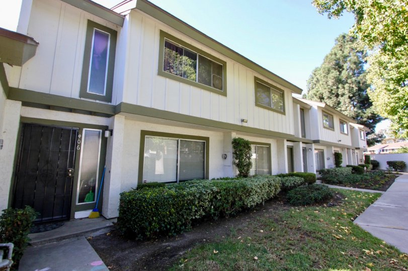 Two story town homes units with small lawns in Pepperwood Villas at Oceanside CA