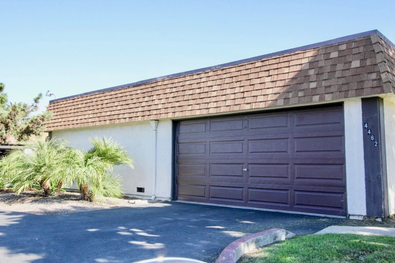 Large brown garage attached to a building in Riverdale, Oceanside, California.