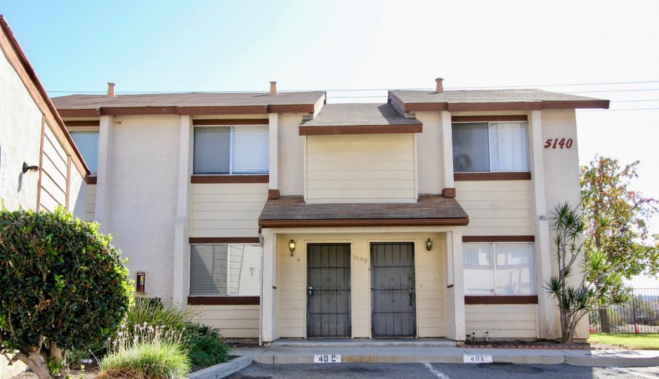 Two story housing with black iron doors inside the Riverview Townhomes in Oceanside CA