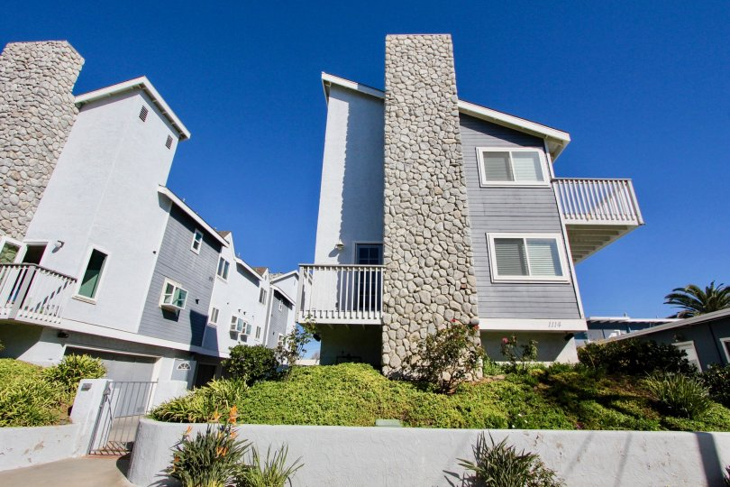 Three story town homes with very large chimney inside S Tait Street Condos inside Oceanside CA