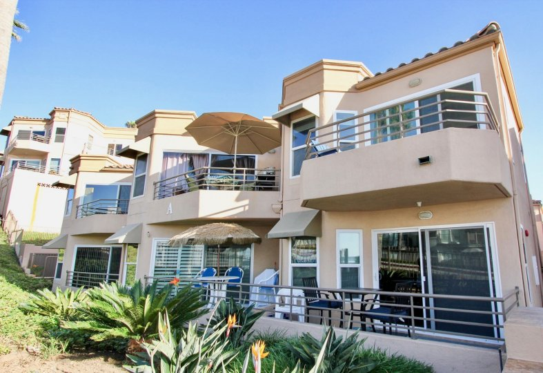 Pastel colored villa style units with upper and lower balconies in the community of San Miguel II in Oceanside, CA