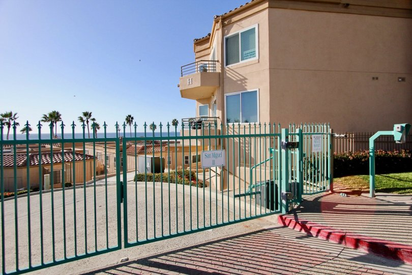 Light blue security fence across a driveway inside San Miguel III at Oceanside CA