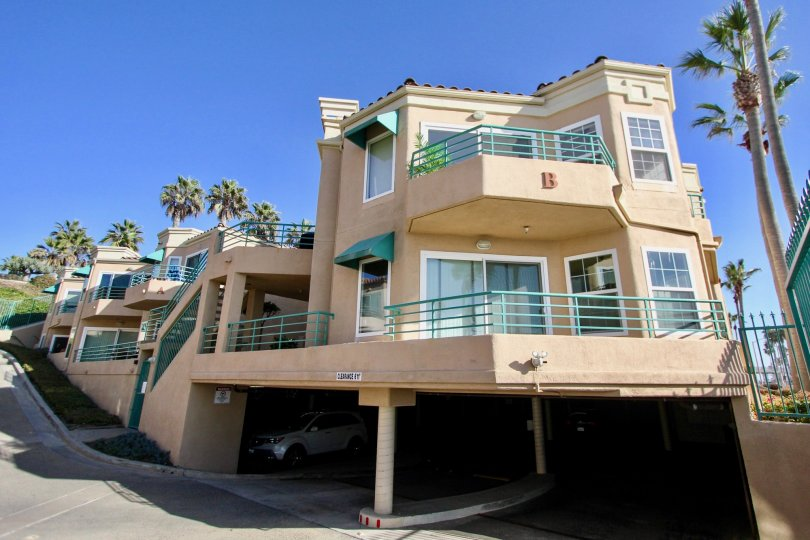 Two story residential units with large patios and parking underneath at San Miguel III in Oceanside CA
