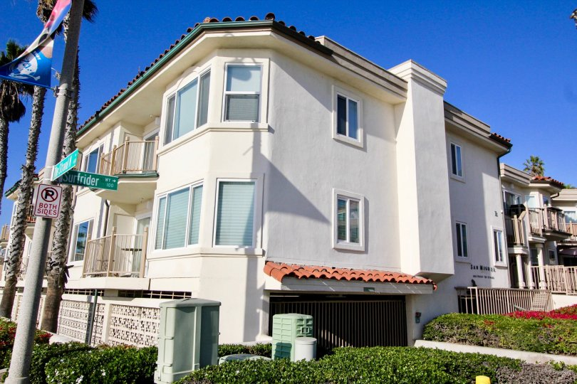 Three story white condos with parking underneath inside San Miguel in Oceanside CA