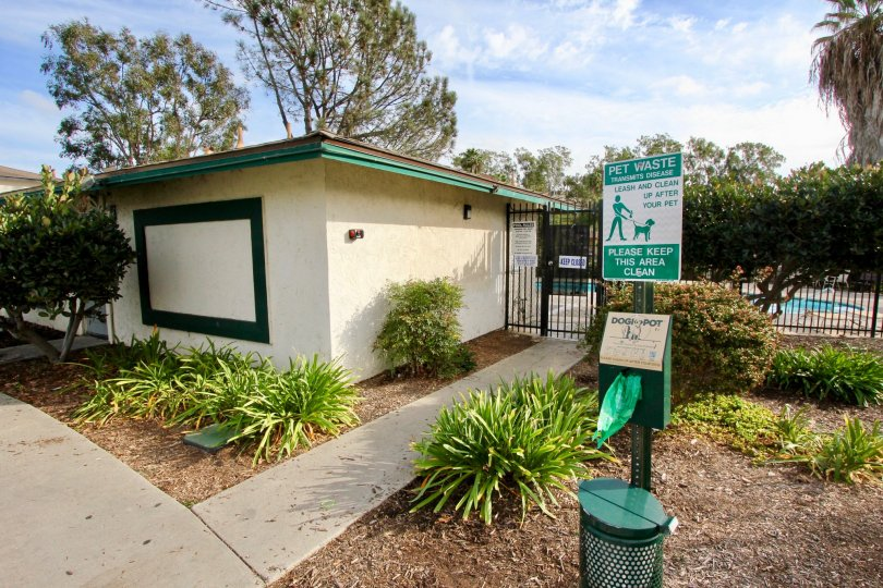 A park with a lovely pool and beautiful flora in this Oceanside community