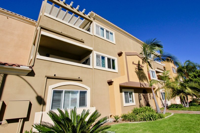 In the Summit Village community of Oceanside, CA a tan complex is made of cement.