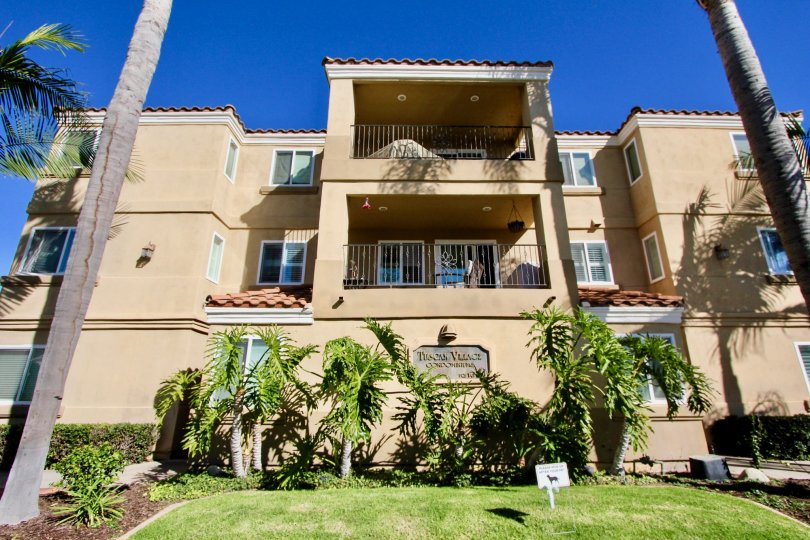 Tall palms and large balconies can be found in Tuscan Village Condos.