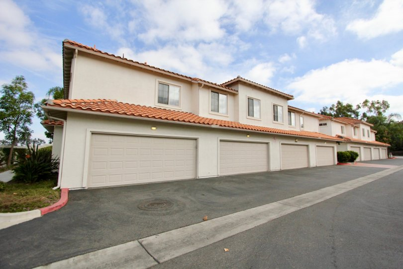 A row of town home garages in Oceanside, CA at Villas at Mission Point