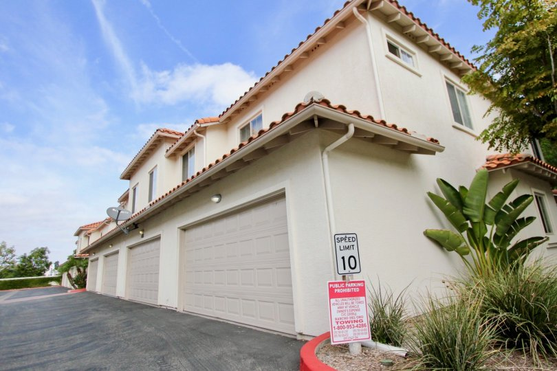 Private parking lot and tucked under garages at Villas at Mission Point in Oceanside, California.