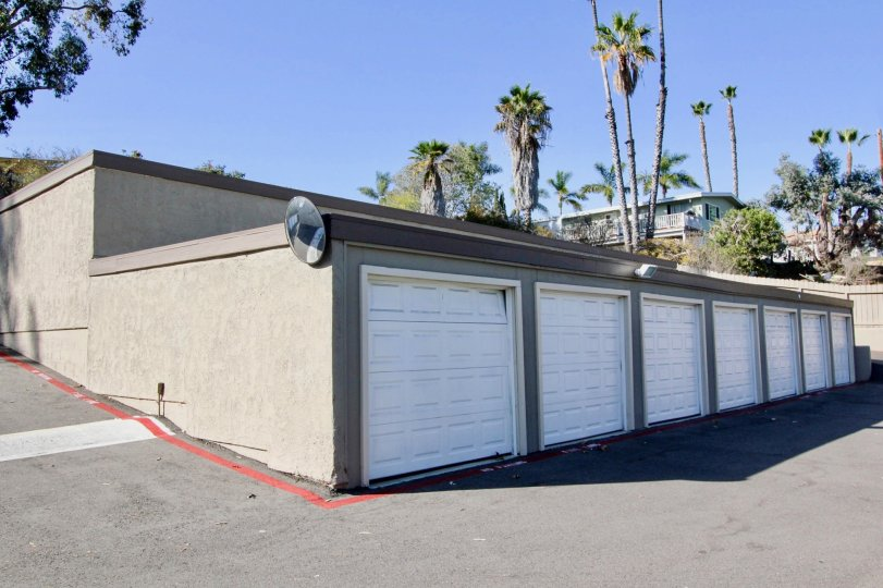 Seven white garage doors on a single story building in Vine Villas at Oceanside CA