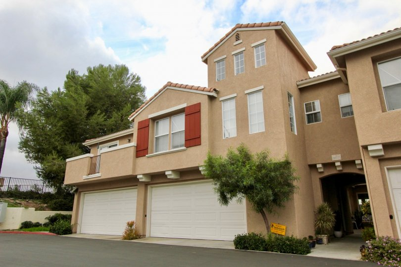 A two story property with two garages and an arched entryway at Vista Monte