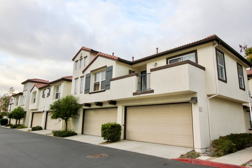 Tucked under garages and private balconies at Vista Monte in Oceanside, California