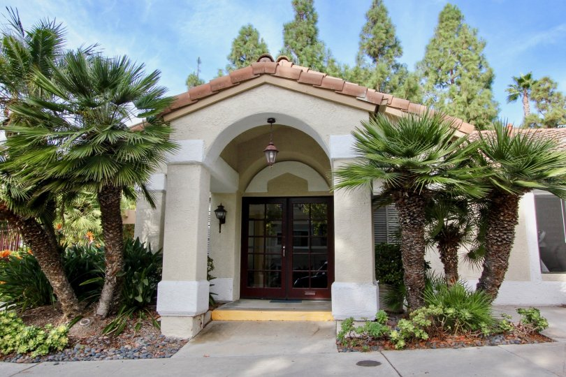 Palm tree flanked entryway to home in the Vista Way Village community in Oceanside, CA