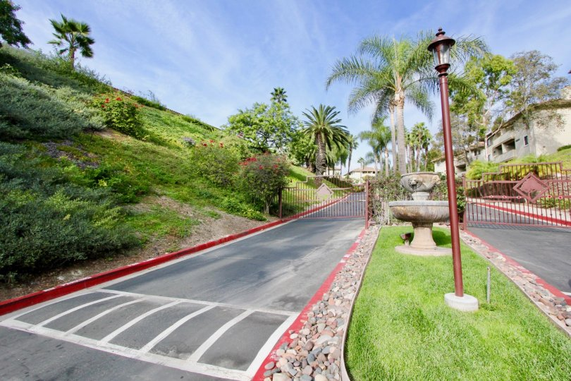 Gated entranceways with landscaped median with designer street lamps at the Vista Way Village in Oceanside, CA