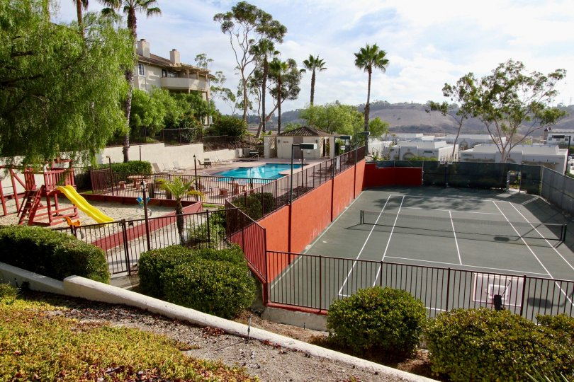 Tennis court, swimming pool and playground all fenced in for residents at Vista Way Village