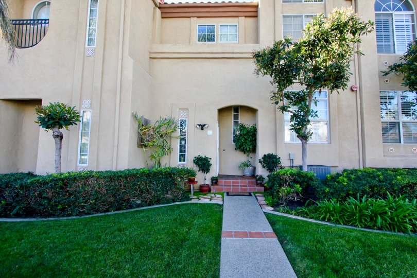 THE APARTMENT IN THE WIND & SEA TOWNHOMES WITH THE GRASSLANDS, FLOWER WASH, TREES, PLANTS.