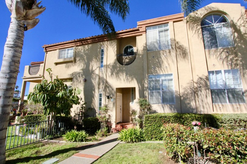 Two story pink condos with a yard in Oceanside CA at Wind & sea townhomes