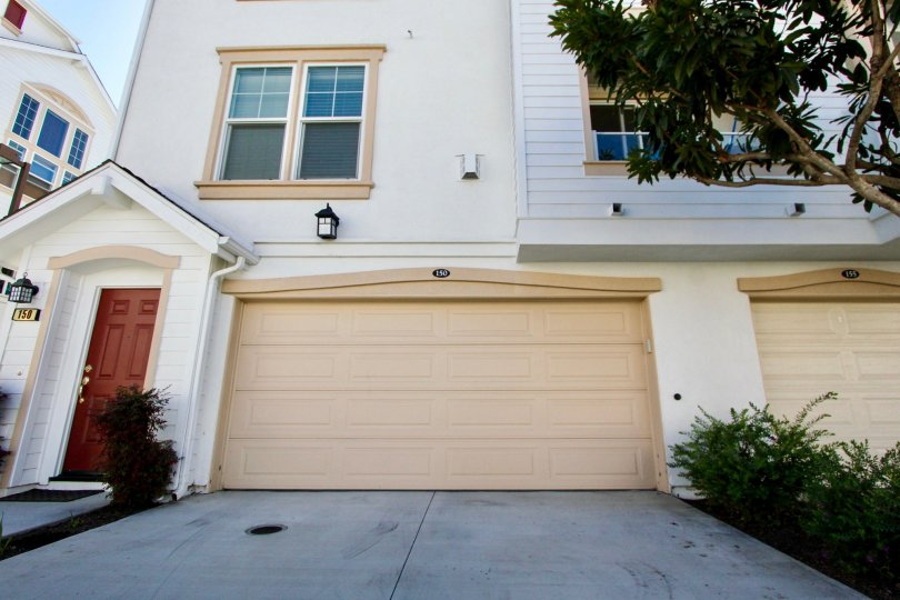 Windward Community, Oceanside, California, Front of House with Garages