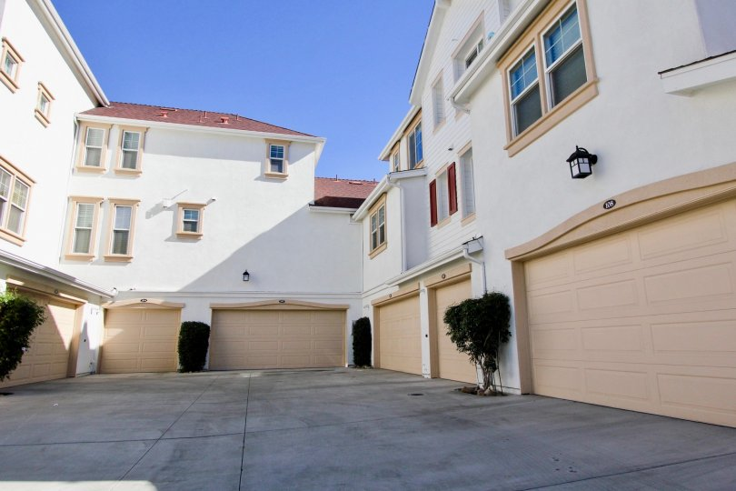 Six garages in an alley for the town homes of the Windward community