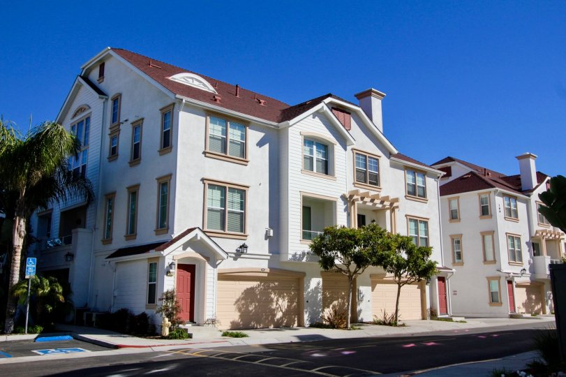 A beautiful day outside large multi-family homes in Windward in Oceanside, CA