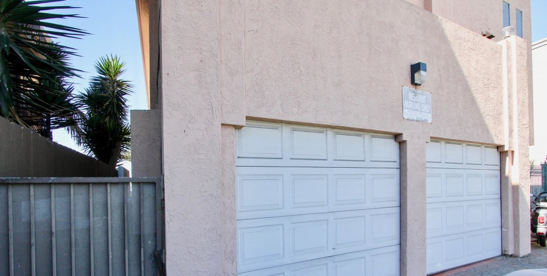 Two white garage doors around a light inside 3802 Riviera Condos at Pacific Beach CA