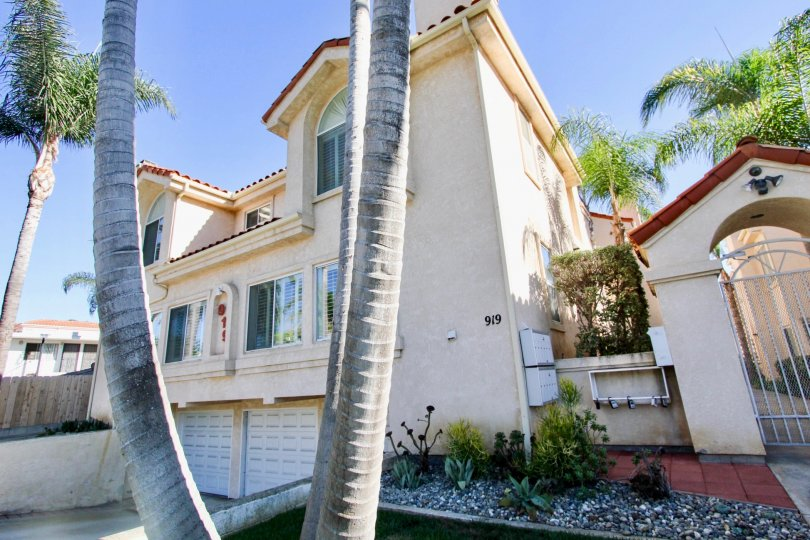 One of the two story properties in Agate Manor surrounded by palm trees
