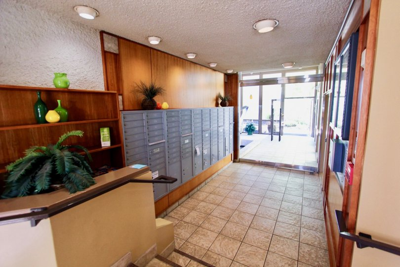 Entrance foyer/lobby with tile floors and wood paneling on walls with glass doors at Bay Scene