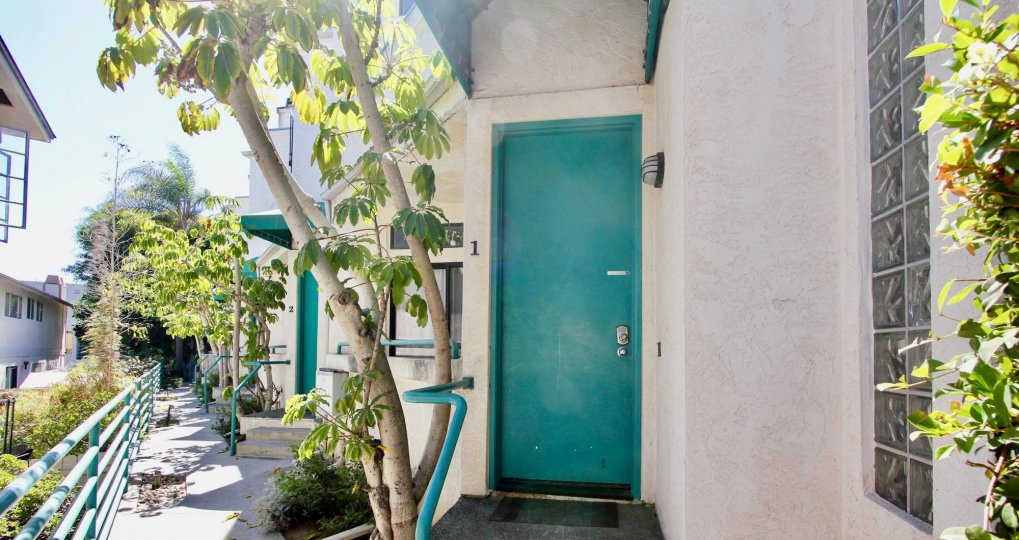 The turquoise door of an apartment in Pacific Beach, CA.