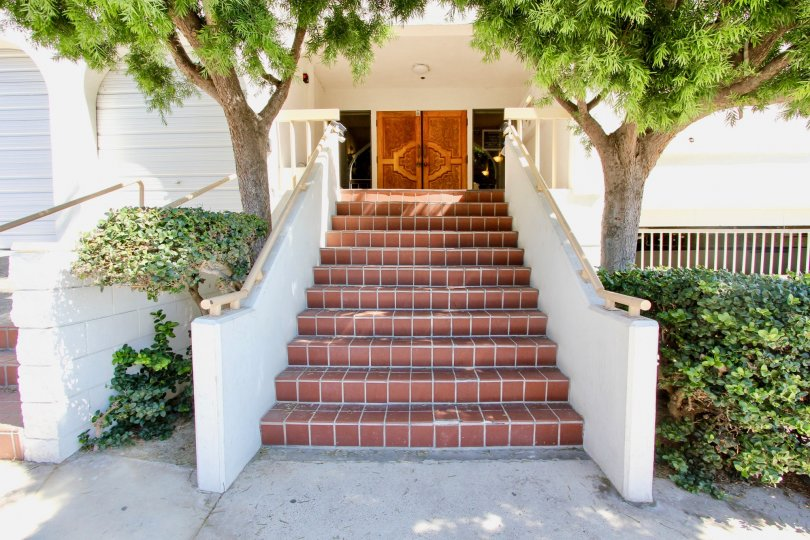 Front entrance gate view with staircase of Castaway community residence, Pacific Beach, CA