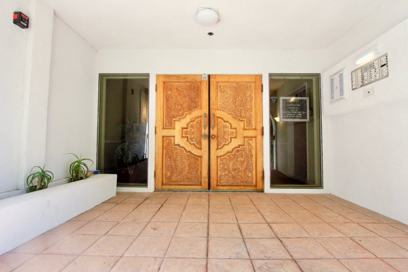 Ornate decorative entrance doors with large side windows at Castaway