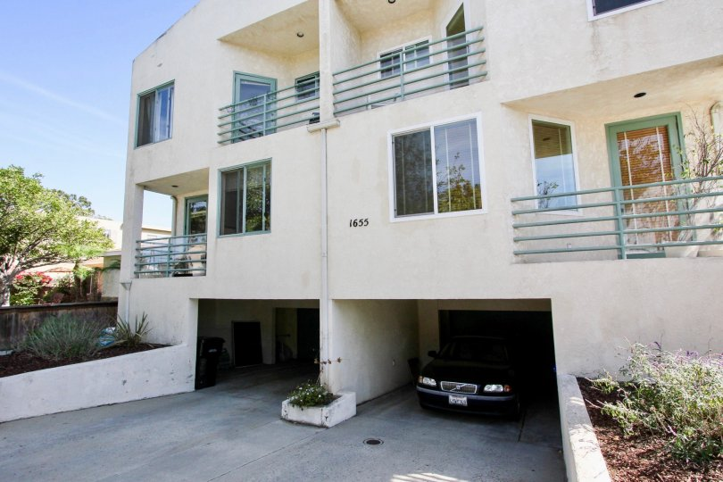 A sunny day in TheChalcedony Townhomes with beautiful Grden and car parking porch