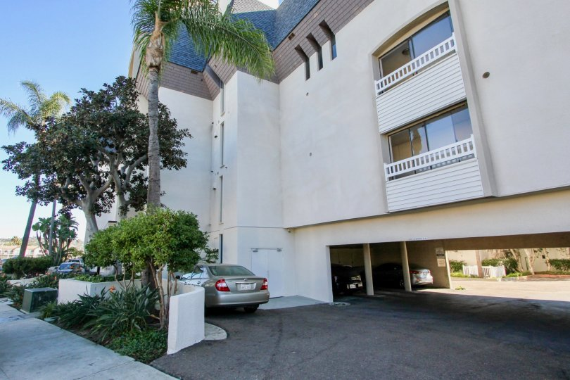 Apartment in Crown Point Villas has glass door balcony with trees and car parking facility