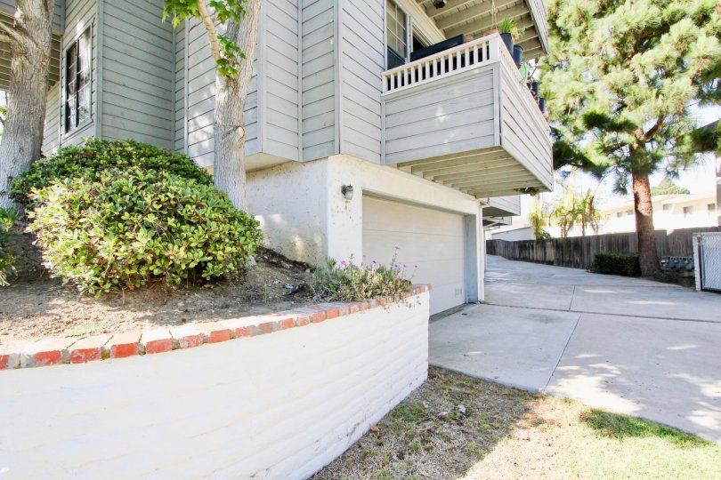 Excellent approach of house with trees and car parking in Diamond by the Bay of Pacific Beach area