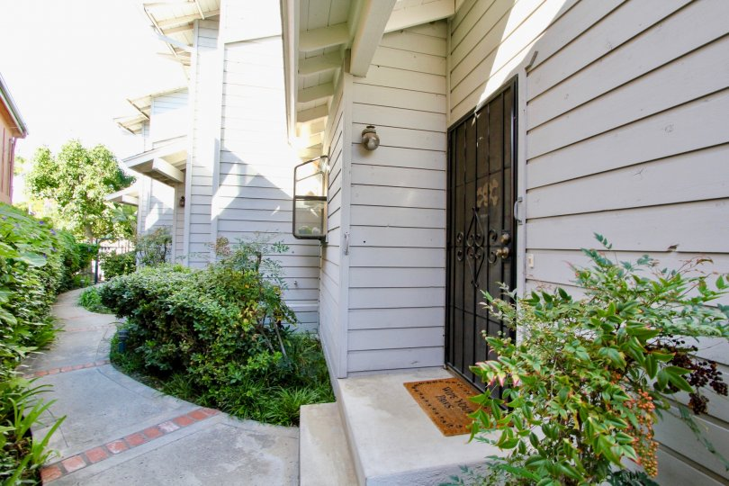 An entryway to townhouses in the Diamond by the Bay community with wood cladding.